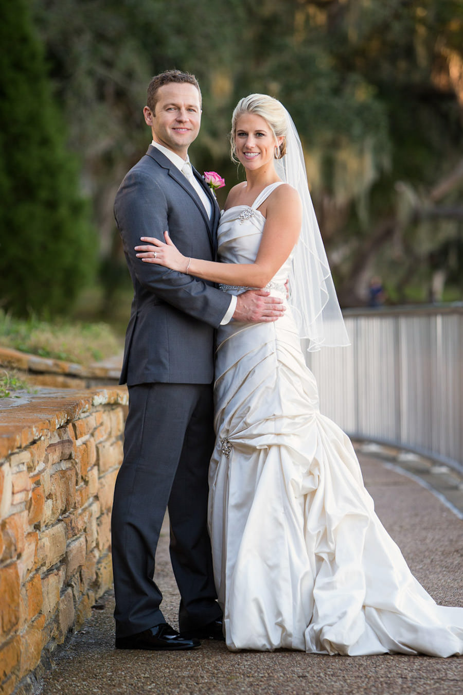 Outdoor, St. Pete Bride and Groom Wedding Portrait in Ivory Allure Wedding Dress and Grey Groom's Suit | St. Pete Wedding Photographer Jeff Mason Photography