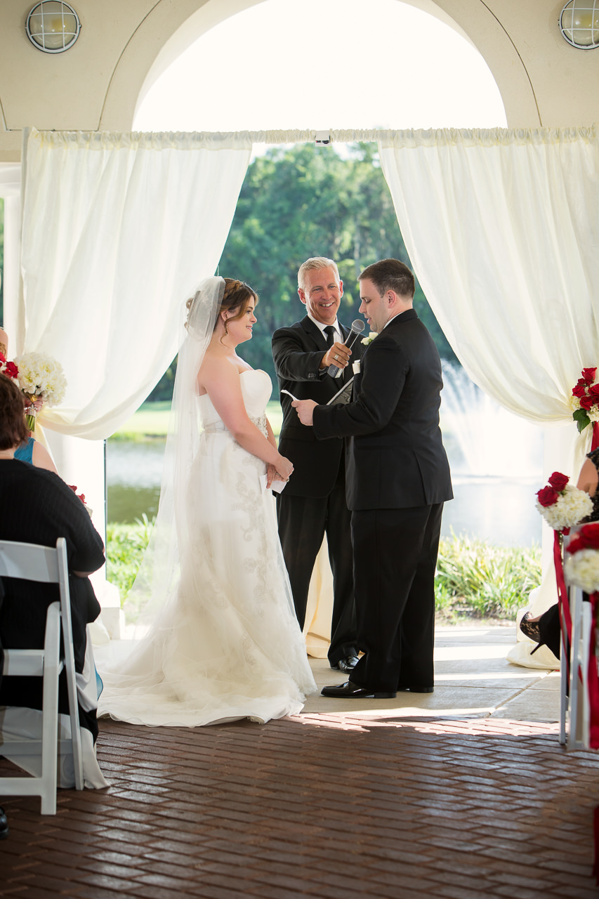 Bride and Groom Exchanging Vows at Tampa Wedding Ceremony | Tampa Wedding Venue Tampa Palms Golf and Country Club | Tampa Wedding Photographer Jeff Mason Photography