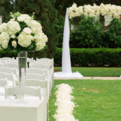 Outdoor Garden Wedding Ceremony With White Hydrangea and Tulle Arch with White Resin Folding Chairs | White and Gold Wedding Ideas | Tampa Wedding Venue The Palmetto Club | Jeff Mason Photography