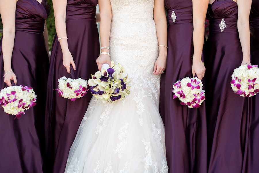 Tampa Bride and Bridesmaids Wedding Portrait with Purple, Pink, and White Floral Wedding Bouquet of FlowersOutdoor, Tampa Wedding Portrait, Bride Spinning in Wedding Dress Tampa Wedding Photographer Caroline & Evan Photography
