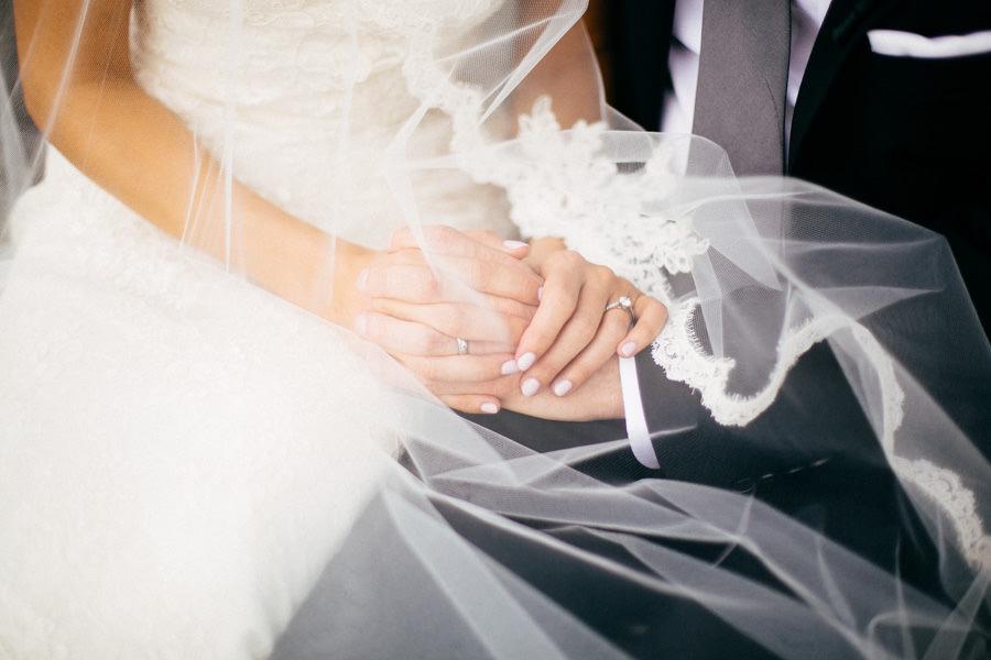 Sarasota Wedding Portrait of Bride and Groom Holding Hands