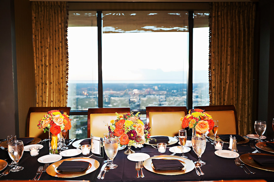 Orange and Yellow Rose Wedding Centerpieces on Black Linens at Tampa Wedding Venue The Tampa Club   Fall Wedding Décor Ideas   Limelight Photography