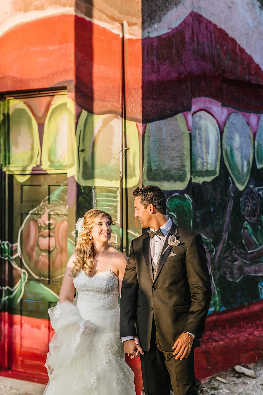 Bride and Groom Outdoor Downtown St. Pete Wedding Portrait with Graffitti Backdrop | Wedding Hair and Makeup Artist Michele Renee The Studio