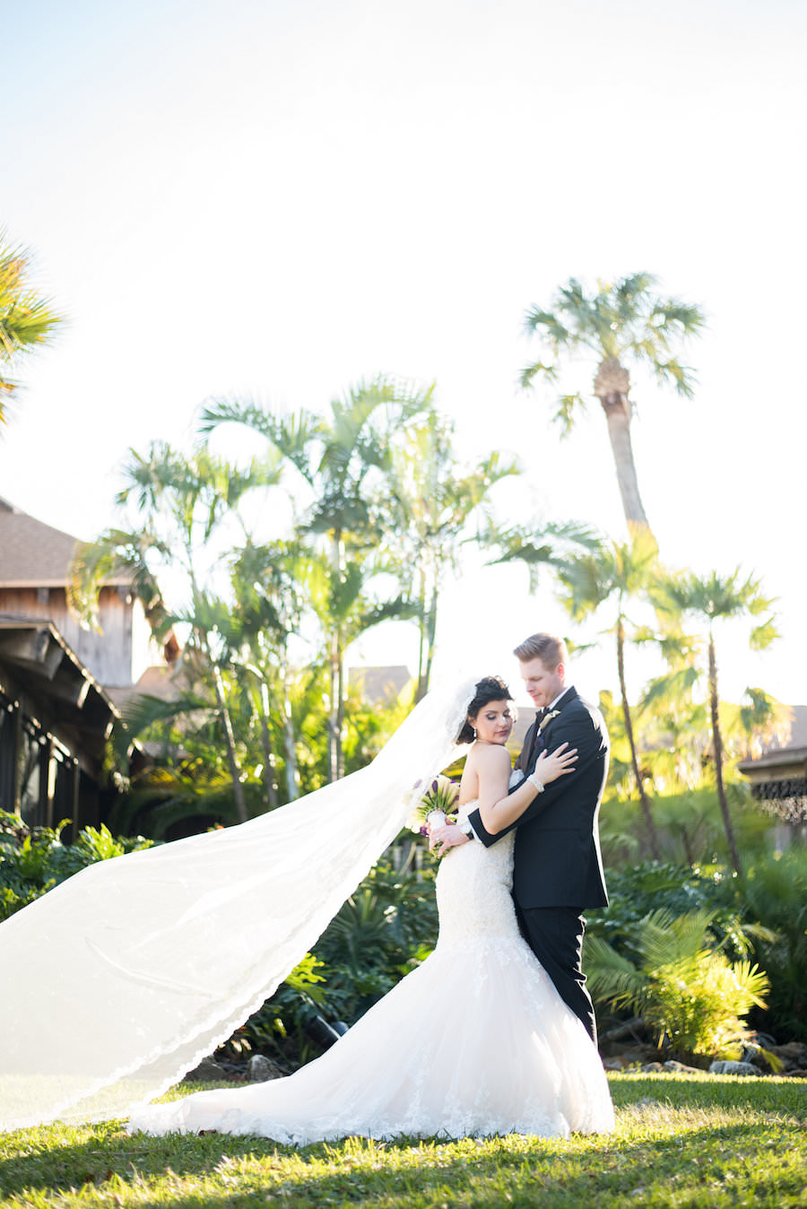 Outdoor, Tampa Bride and Groom Wedding Portrait with Flowing Chapel Veil   Tampa Wedding Photographers Caroline and Evan Photography