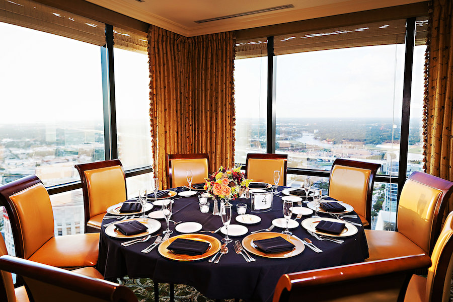 Fall Inspired Wedding Reception Décor with Orange and Yellow Centerpieces on Black Linens at Tampa Wedding Venue The Tampa Club   Limelight Photography