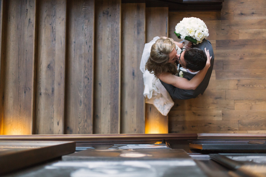 Wedding Portrait, Bride and Groom Kissing on Stairs