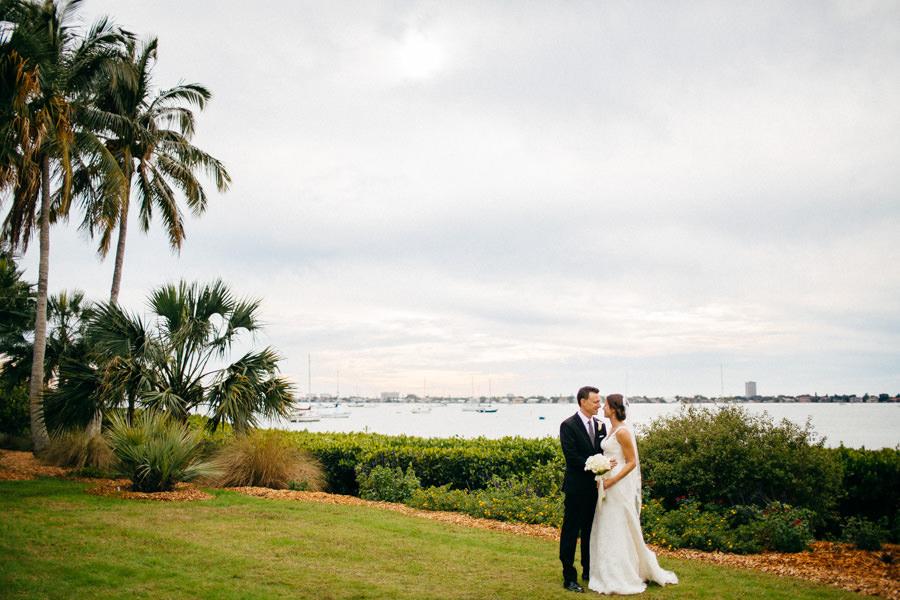 Outdoor, Waterfront Bride and Groom Wedding Portrait at Sarasota Wedding Venue Marie Selby Gardens