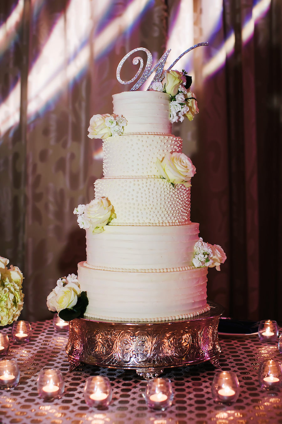 Traditional Five Tier Round White Wedding Cake with White Roses and Silver Initial Cake Topper on Silver Specialty Linen | Wedding Cake by the Vinoy Renaissance | St. Petersburg Wedding Photographer Limelight Photography