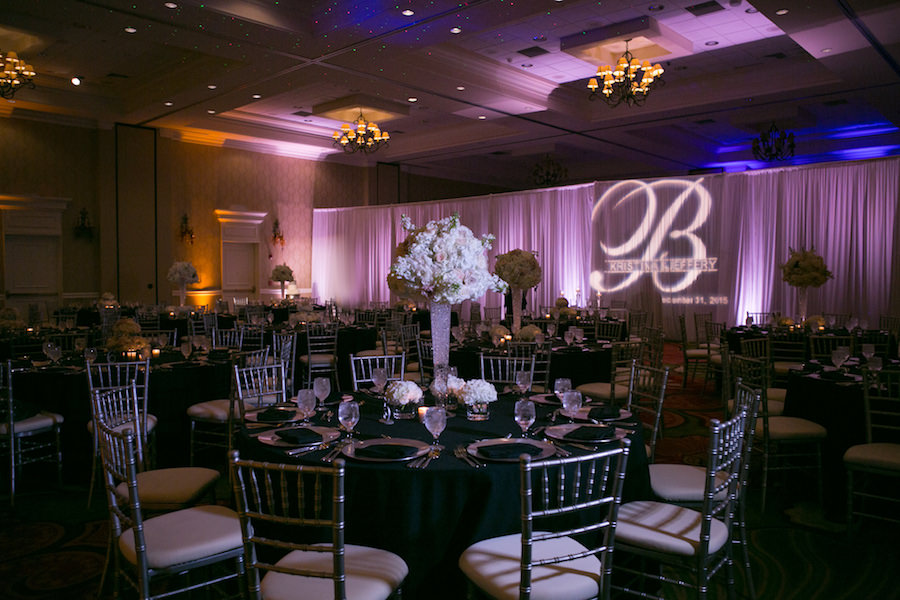 Classic, New Year's Eve Wedding Reception with Blush Pink and White Tall Centerpieces, Black Linens, Uplighting and Silver Chiavari Chairs | St. Petersburg Wedding Venue Vinoy Renaissance