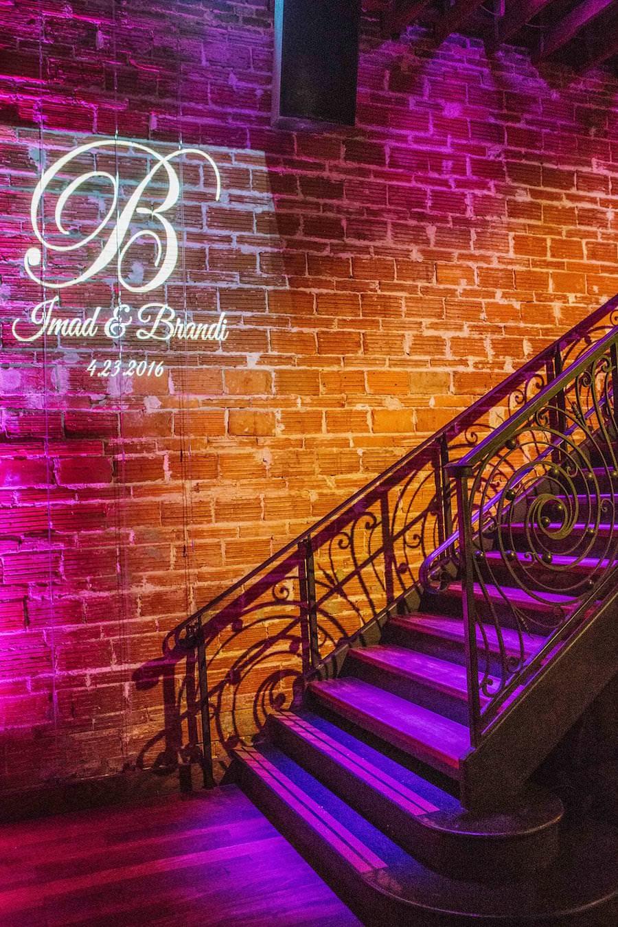 Wedding Reception with Purple and Gold Uplighting and Custom GOBO Monogram Initials | Downtown St Pete Wedding Venue NOVA 535