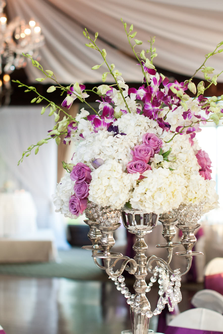 Tampa Wedding Reception Table Decor with Purple and White Floral Centerpieces with Candelabra