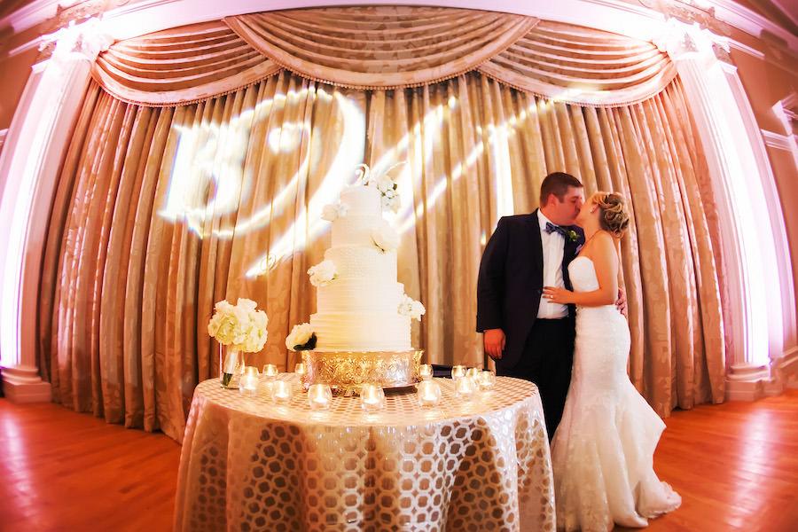 Bride and Groom Wedding Portrait With Five Tier Round White Wedding Cake | Limelight Photography St Petersburg Florida Wedding Photographer | Downtown St. Pete Wedding Venue Vinoy Rennaisance