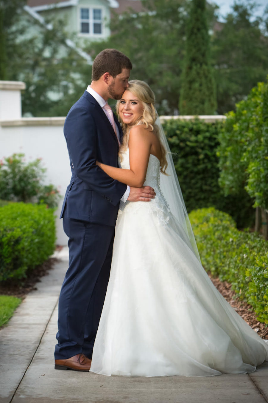 Outdoor Bride and Groom Wedding Portrait in Navy Blue Suit and Ivory Watters Wedding Dress | Tampa Bay Wedding Photographer Jeff Mason Photography