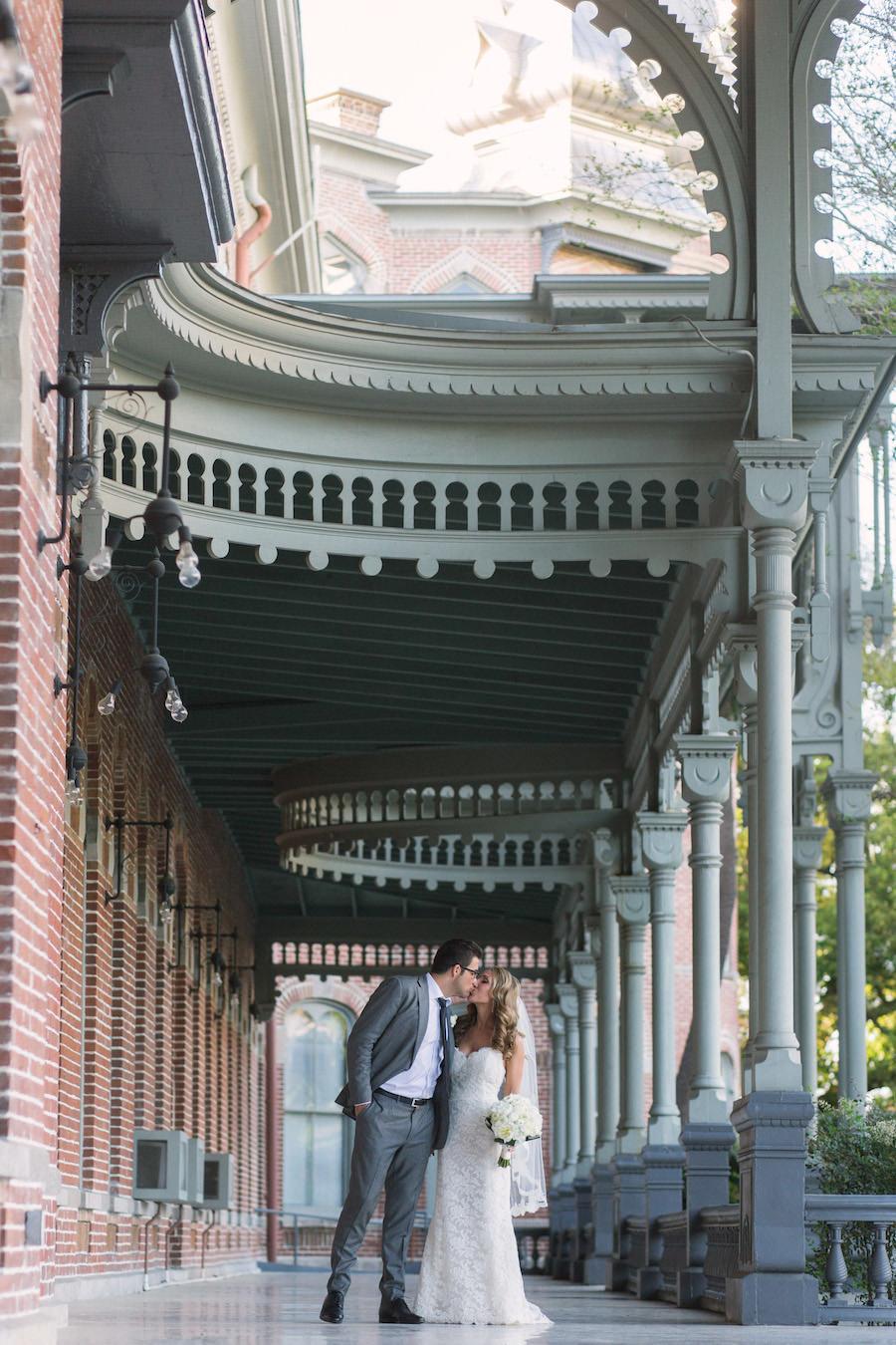 Outdoor Bride and Groom Wedding Portrait Kissing   University of Tampa Wedding Location