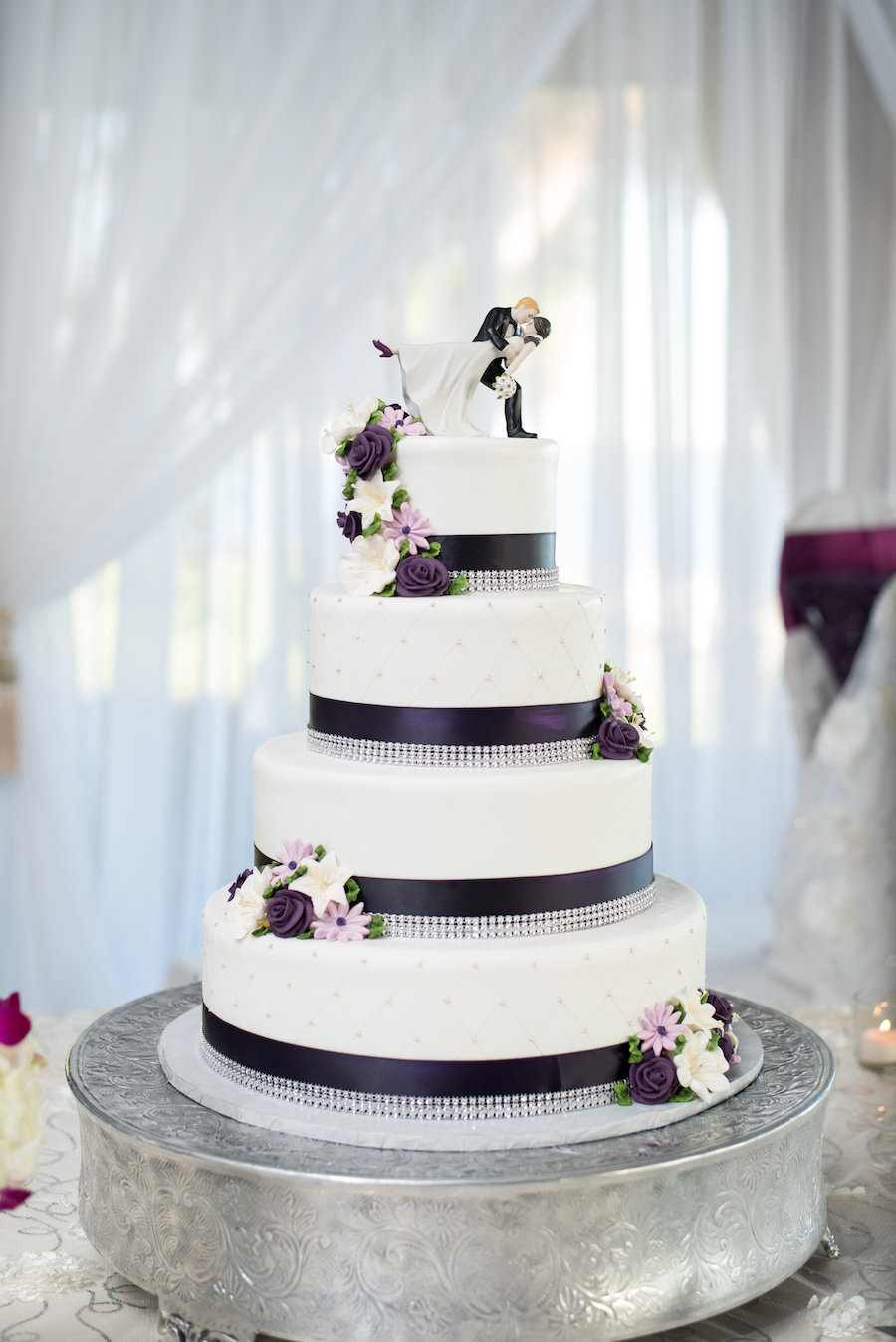Four Tiered, White, Round Wedding Cake with Purple and Crystal Accents   Tampa Wedding Photographers Caroline and Evan Photography