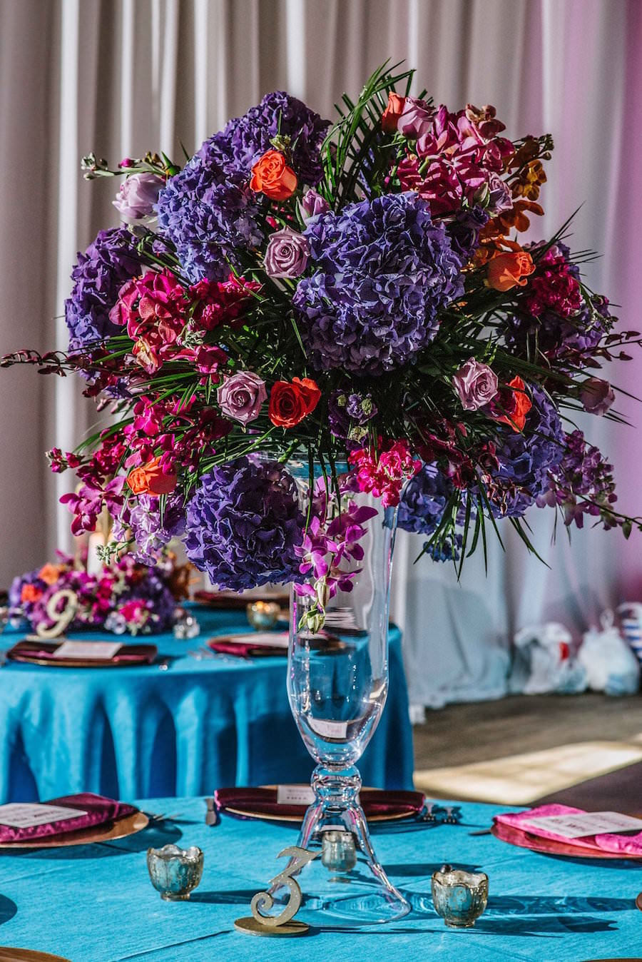 Tall Purple Orange And Magenta Wedding Centerpiece Flowers In Glass