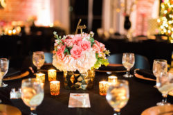 St. Pete Wedding Reception Table Decor with Candlelight and Ivory and Coral Bouquet of Flowers in Gold Centerpieces with Script Gold Table Numbers