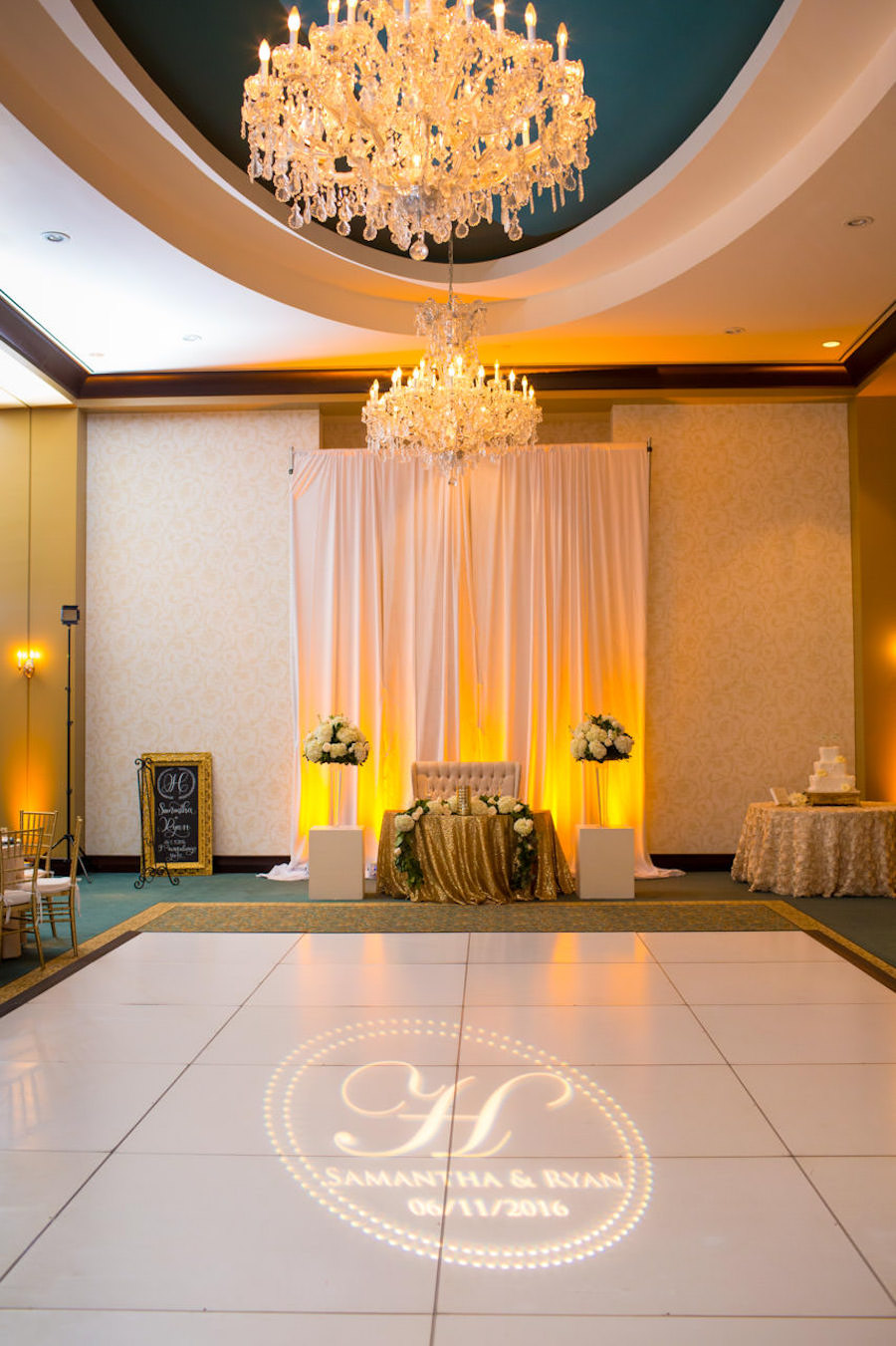 Elegant, White and Gold Wedding Reception Head Table With White Centerpieces on Gold Specialty Linens at Tampa Bay Wedding Ceremony and Reception Venue The Palmetto Club | Wedding Photographer Jeff Mason Photography