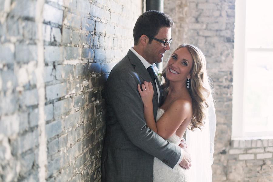 Bride and Groom Indoor Wedding Portrait by Brick Wall