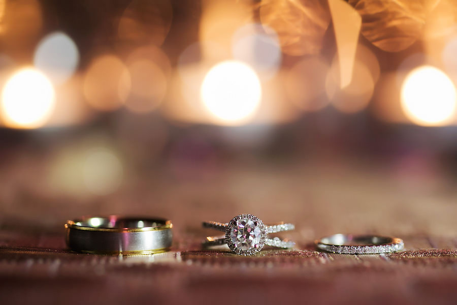 Brilliant Cut Halo Engagement Ring with Wedding Rings in Bokeh Light Portrait | St Petersburg Wedding Photographer Limelight Photography