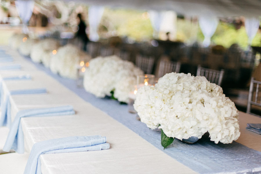 Wedding Reception Table Decor with Silver Chiavari Chairs, Blue Crushed Linens and White Floral Hydrangeaa Centerpieces