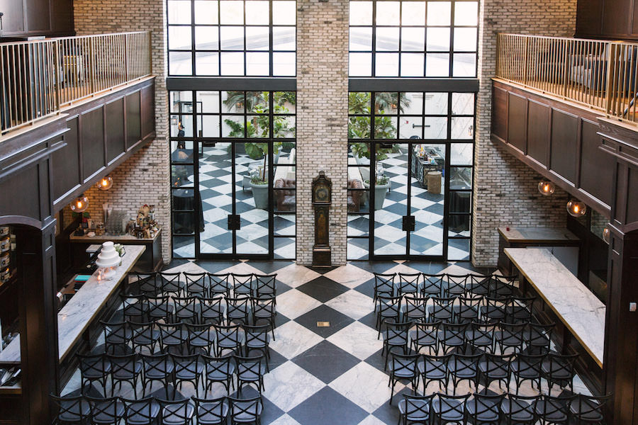 Indoor Wedding Reception with Checkered Floor and Black Chairs at South Tampa Modern, Vintage Wedding Venue Oxford Exchange | Tampa Wedding Planner Southern Elegance Events