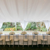 Wedding Reception Tent Table Decor with Silver Chiavari Chairs and White Hydrangea Floral Centerpieces | Sarasota Wedding Venue Marie Selby Gardens
