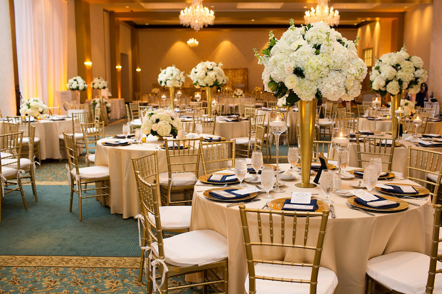 Gold Wedding Reception with Ivory and White Tall Centerpieces and Gold Chargers and Chiavari Chairs | Tampa Bay Wedding Ballroom Venue The Palmetto Club