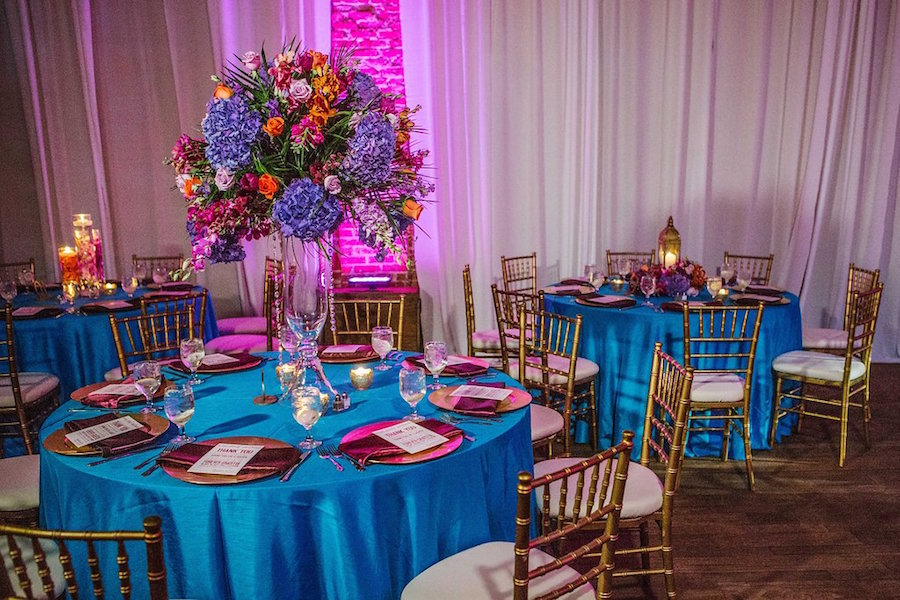 Wedding Reception With Gold Purple Orange And Teal Centerpieces