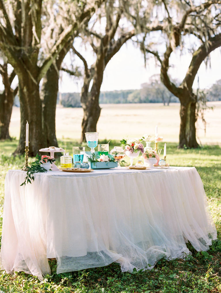 DIY Wedding Reception Favor Table with Hand Painted Cookie Bar and Tulle Tableskirt with Vintage Pieces | Tampa Wedding Rentals by Ever After Vintage Rentals