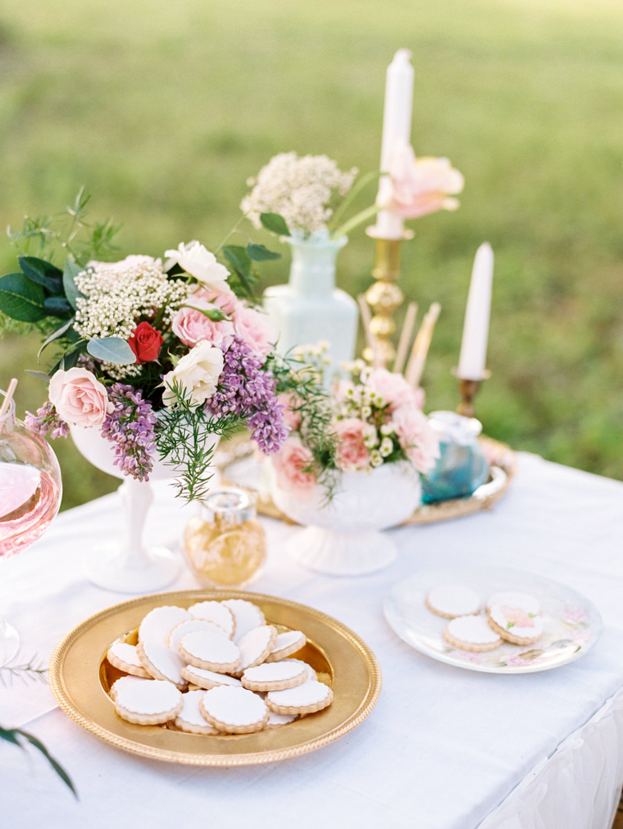 DIY Wedding Reception Favor Table with Hand Painted Cookie Bar and Tulle Tableskirt with Vintage Pieces and Garden Floral Arrangements with Blush, Purple and Ivory Flowers| Tampa Wedding Rentals by Ever After Vintage Rentals