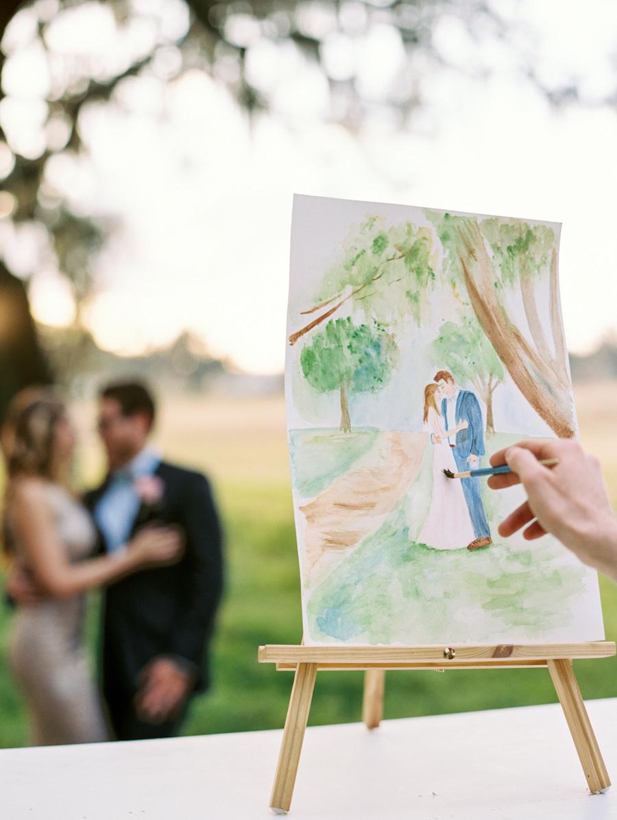 Outdoor Tampa Wedding Portrait of Bride and Groom with Watercolor Portrait Artist