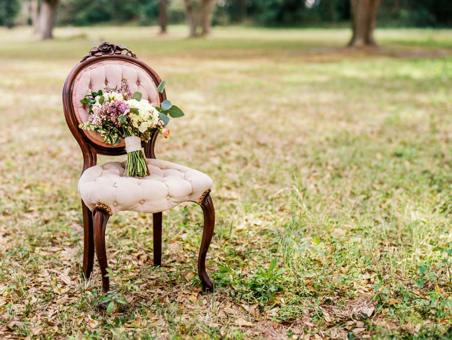 Vintage Outdoor Tufted Wedding Ceremony Seating with Bride's Purple Ivory and Greenery Bouquet | Tampa Vintage Wedding Seating and Chairs by Tufted Vintage Rentals