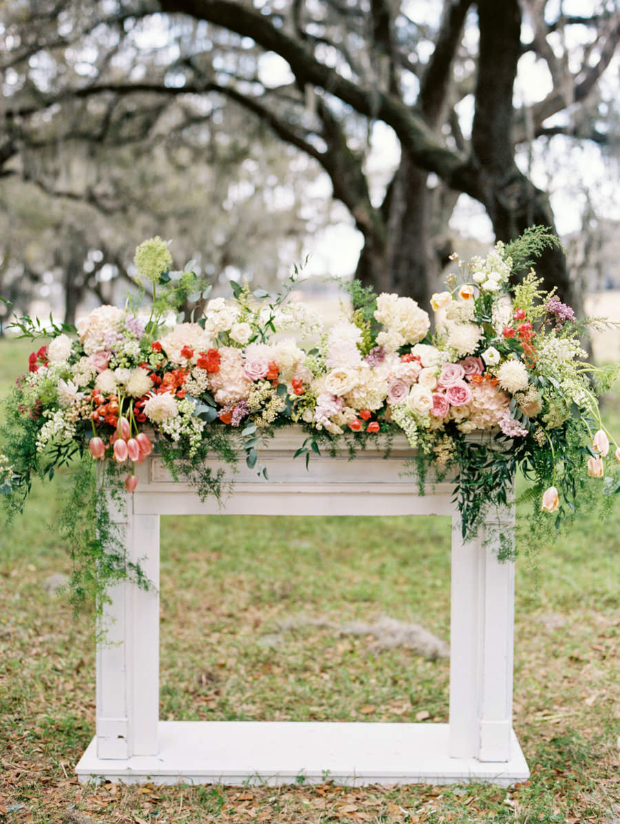 Floral Arbor Fireplace Garland for Outdoor Wedding Ceremony with Lush Arrangement of White and Pink Flowers with Greenery