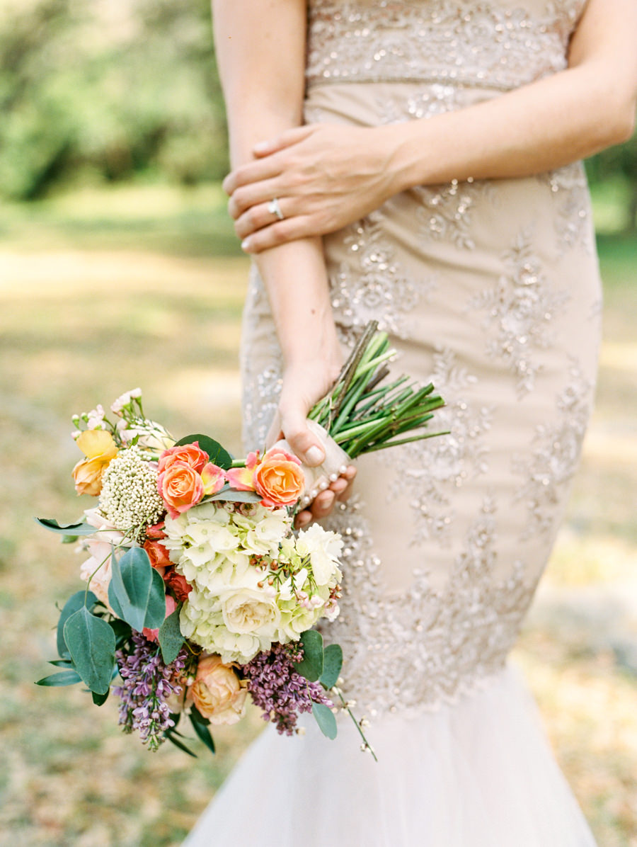Ivory and Champagne Fit and Flare Wedding Dress with Gold Brocade Detail and Garden Inspired Bride's Wedding Bouquet