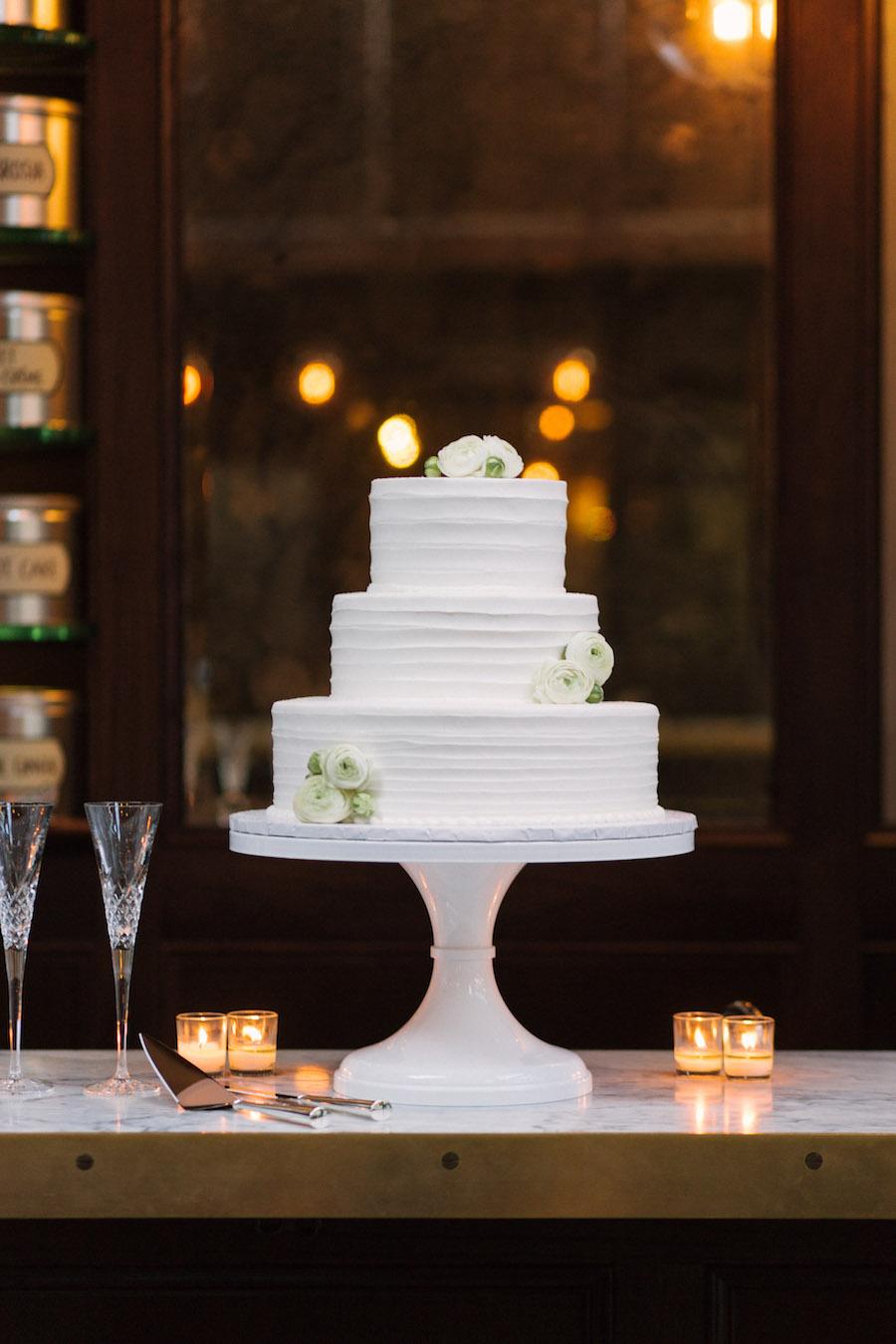 Three Tiered Elegant Round White Textured Wedding Cake