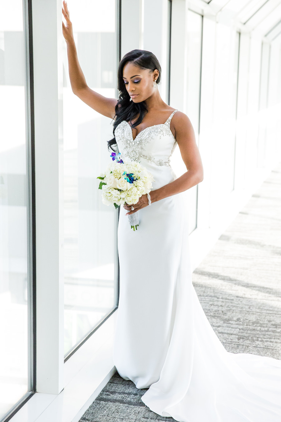 Bridal Portrait Wearing White Beaded Demetrios Bride Wedding Dress   White Wedding Bouquet