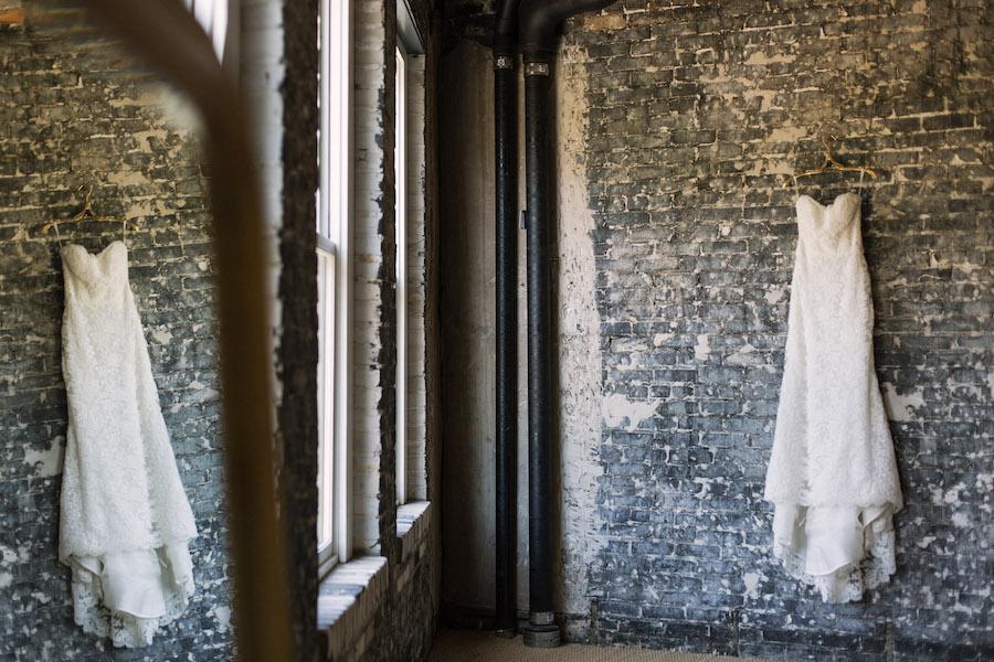 Ivory, Lace Strapless Wedding Dress on Brick Wall