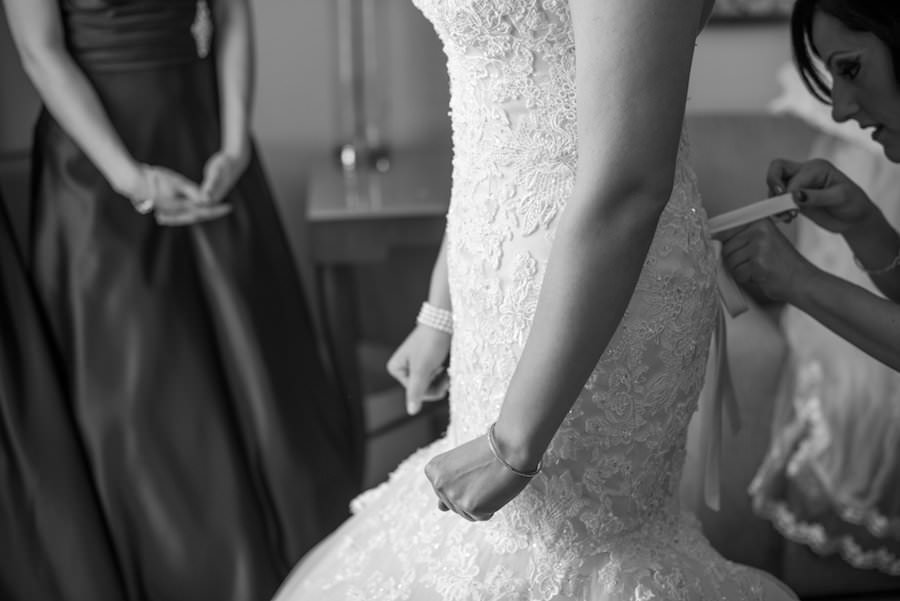 Bride Getting Dressed in Strapless, Ivory, Beaded Lace Wedding Dress  Tampa Wedding Photographers Caroline and Evan Photography