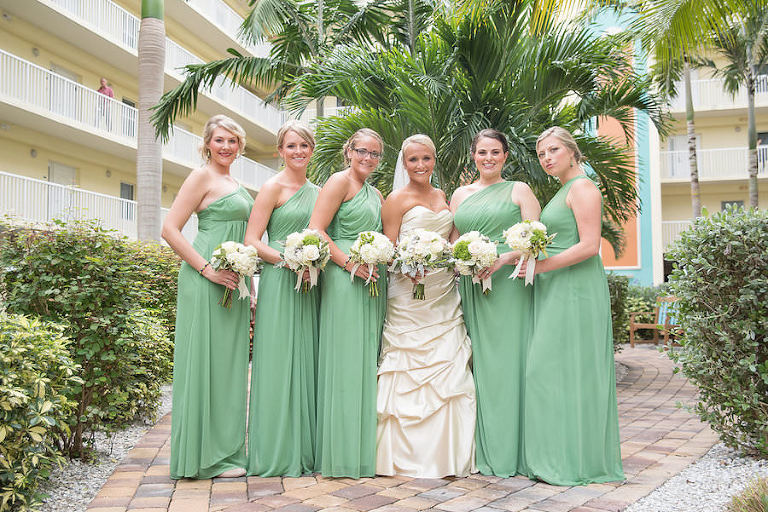 Bridal Party Wedding Portrait Wearing Green One Shoulder Long Bridesmaid Dresses | St. Petersburg Wedding Photographer Kristen Marie Photography