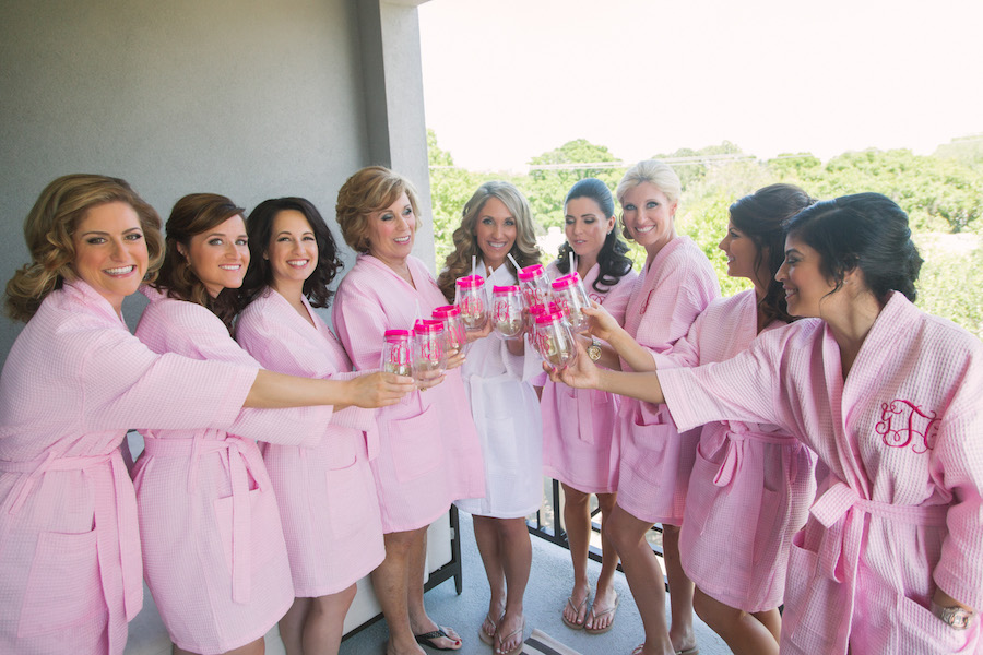 Bride and Bridesmaids in Matching Pink, Monogrammed Robes with Drinks