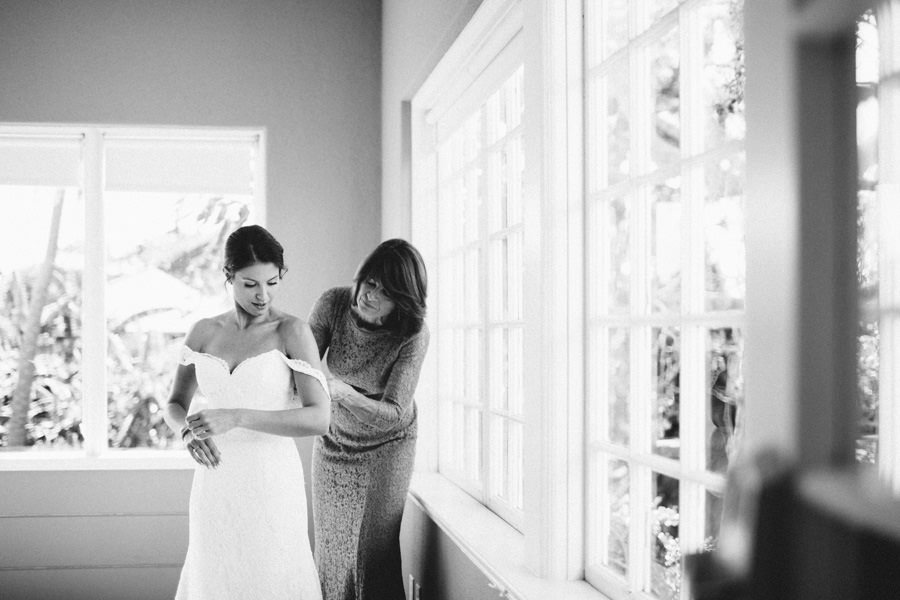 Bride Getting Ready Putting on Wedding Dress with Mother