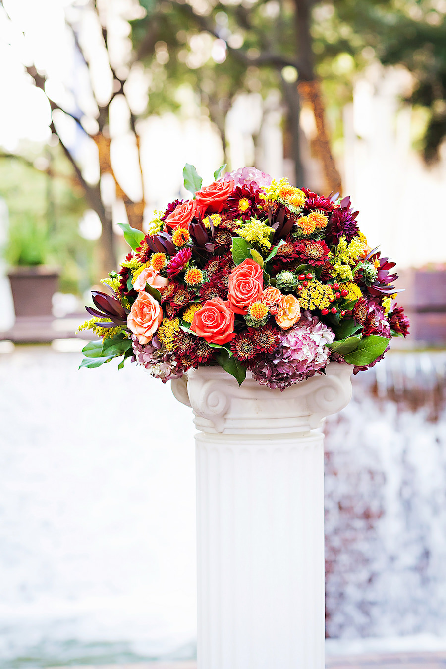 Outdoor Wedding Ceremony Décor with Orange, Yellow and Burgundy Wedding Centerpieces   Tampa Wedding Photographer Limelight Photography