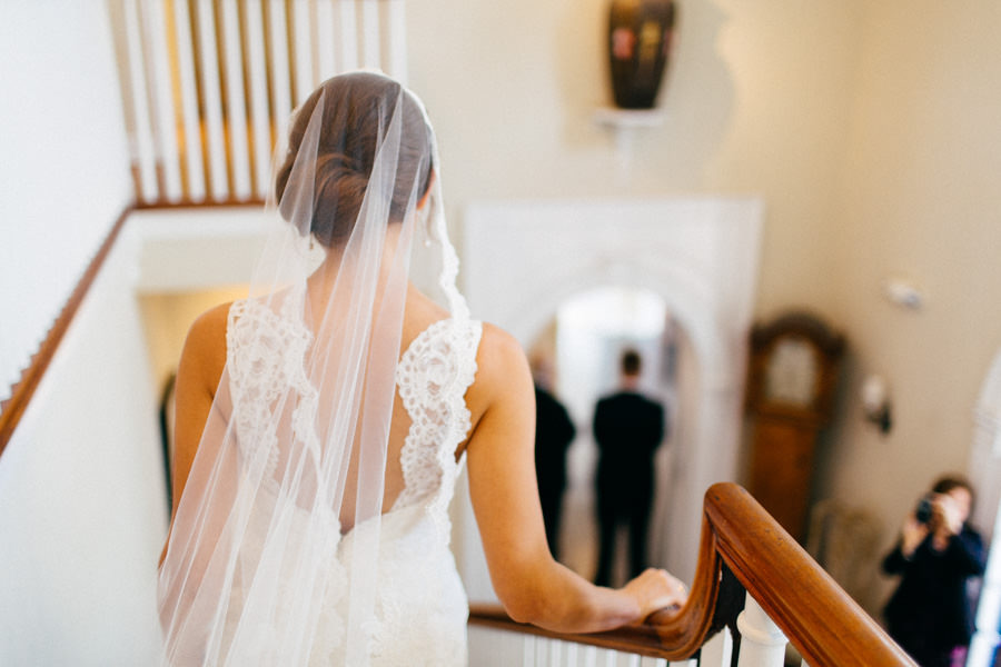 Bride Walking Down Staircase in Ivory, Lace Wedding Dress and Veil