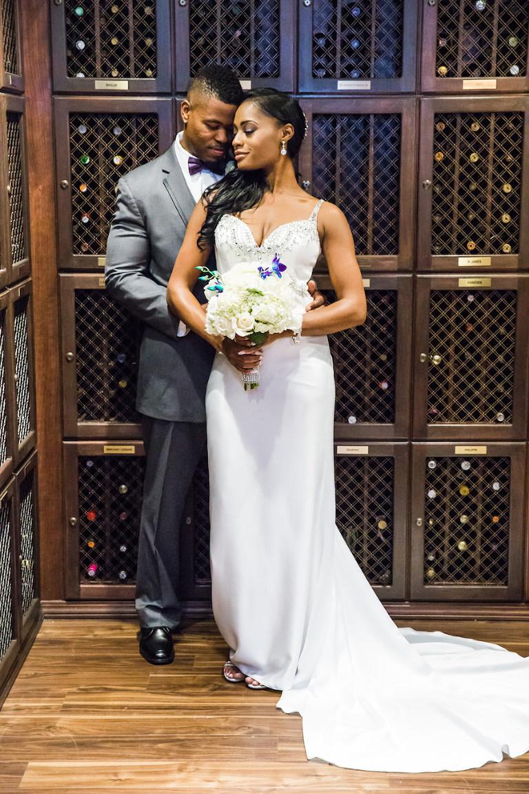 Bride And Groom Wedding Portrait With Beaded Demetrios Dress In Wine Cellar Room