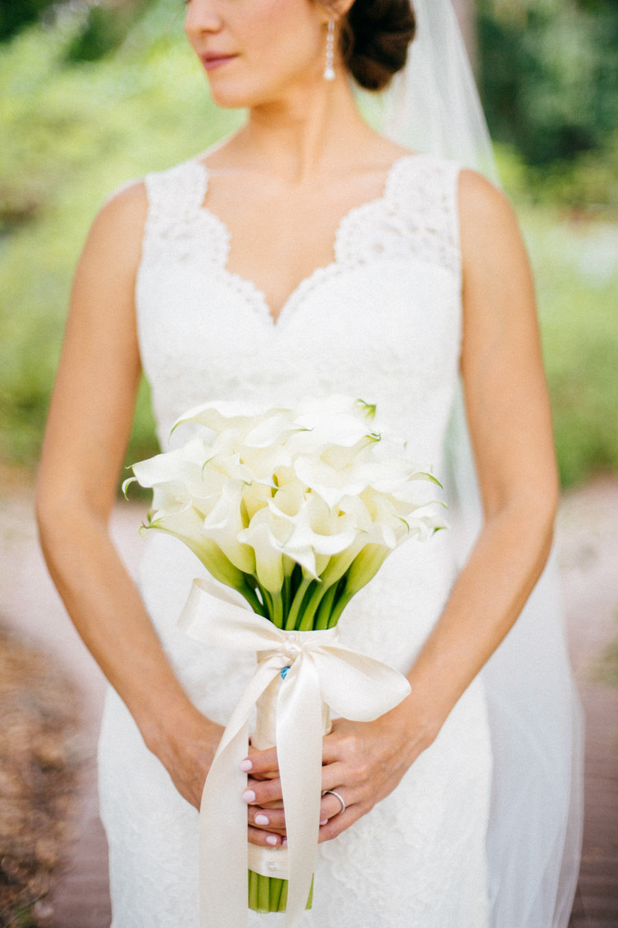 Outdoor, Bridal Wedding Portrait in Ivory, Lace Augusta Jones Wedding Dress, Chapel Length Veil and White Calla Lily Bridal Bouquet