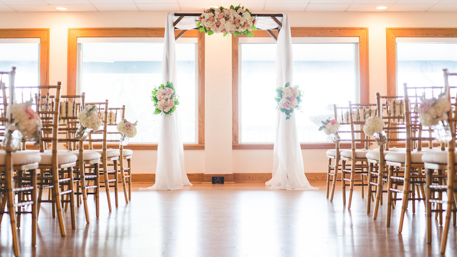 Indoor Wedding Ceremony with Draped Altar and Pink and Ivory Flowers | St. Petersburg Wedding Planner Special Moments | Chair Rentals Signature Event Rentals | Waterfront Wedding Venue Tampa Bay Watch