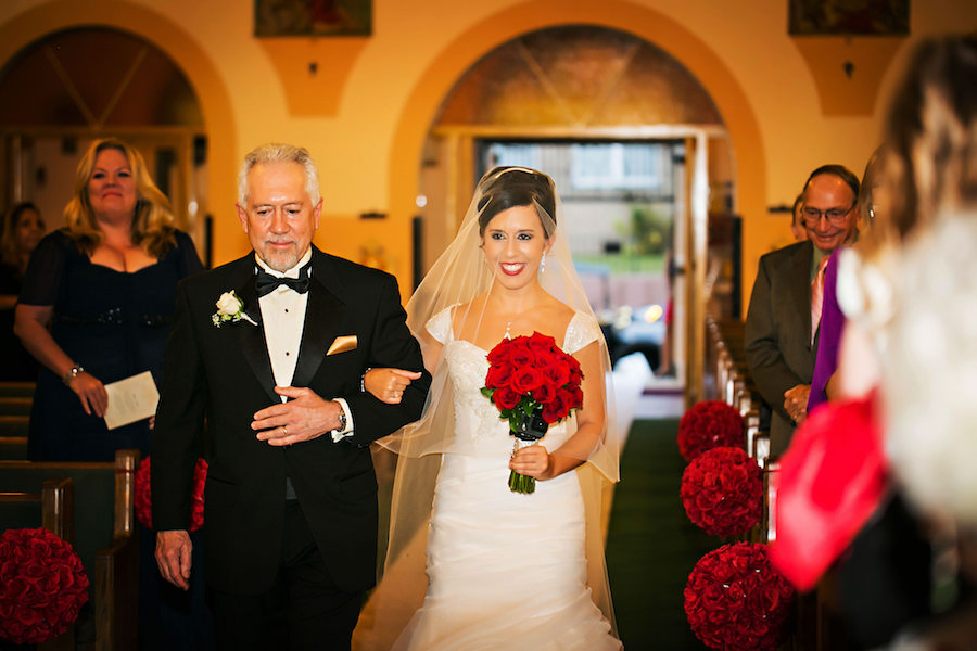 Bride and Father Waking Down Aisle at Tampa Catholic Church Wedding Ceremony   Red Rose Wedding Bouquet