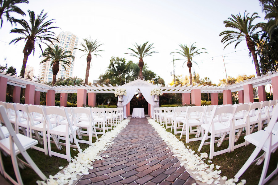 Classic Florida Outdoor Wedding Ceremony Under Palm Trees with White Resin Folding Chairs and White Rose Petals | St. Petersburg Wedding Venue Vinoy Renaissance | Limelight Photography