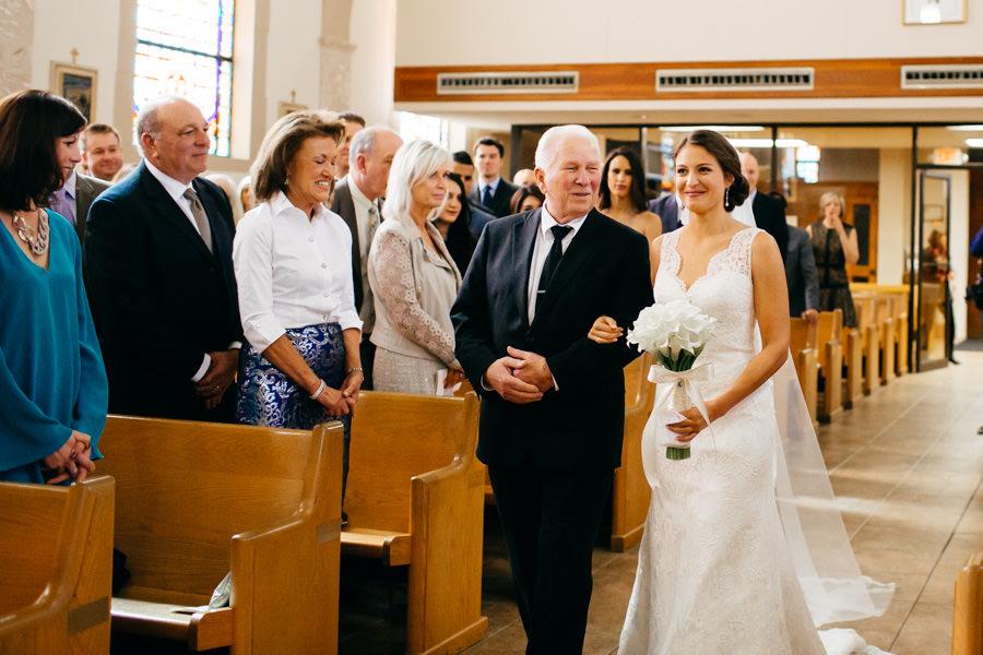 Bride and Dad Walking Down the Aisle at Sarasota Catholic Church Wedding Ceremony at St. Martha's Catholic Church